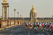 The lead group of cyclists enter Paris to finish the 100th Tour de France. Specialized Bicycle Components hosted a VIP experience for select media joining the last four stages of the 2013 Tour de France. Image by Greg Beadle