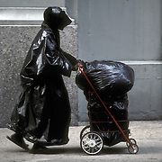 Street person one would avoid, looking crazy, baglady dressed in black garbage bags. re: treatment of mentally ill in society. <br />