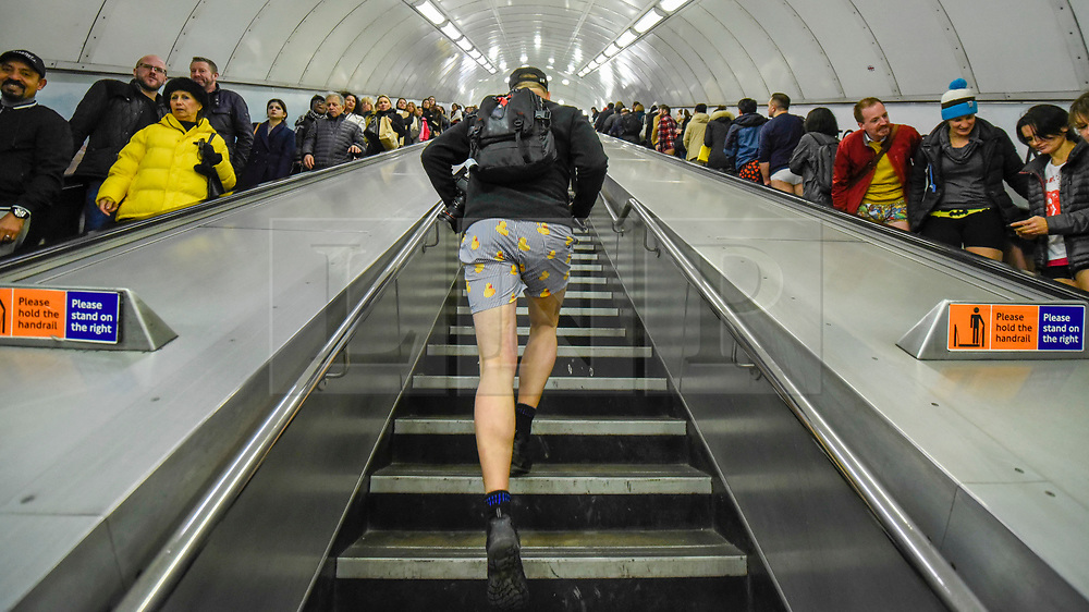 """© Licensed to London News Pictures. 12/01/2020. LONDON, UK. A participant takes part in """"No Trousers On The Tube Day"""".  Now in its 11th year, the annual event sees hundreds of riders travel on the tube without wearing trousers.  Similar rides are taking place worldwide under the umbrella of """"No Pants Subway Ride"""", which launched in New York in 2002.  Photo credit: Stephen Chung/LNP"""