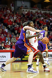 12 January 2008: Anthony Slack continues forward despite getting clotheslined by Clint Hopf during a game in which  the Purple Aces of the University of Evansville lost to  the Redbirds of Illinois State on Doug Collins Court at Redbird Arena in Normal Illinois by a score of 74-66.