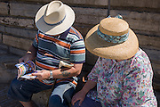 Elderly visitors to Weston-super-Mare read an events brochure on the seaside resort's seafront.
