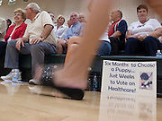 "Aug 10, 2009 -- CHANDLER, AZ: People in Chandler, AZ, wait for a town hall meeting on health care reform to start in Chandler, AZ. Rep. Jeff Flake, (R-AZ) hosted a ""town hall"" style meeting on health care reform at Basha High School in Chandler Monday. Flake, a conservative Republican, has opposed President Obama on many issues, like the stimulus and health care reform. Protestors who have shut down similar meetings hosted by Democrats, gave Flake a warm welome. About 1,600 people attended the meeting.   Photo by Jack Kurtz"