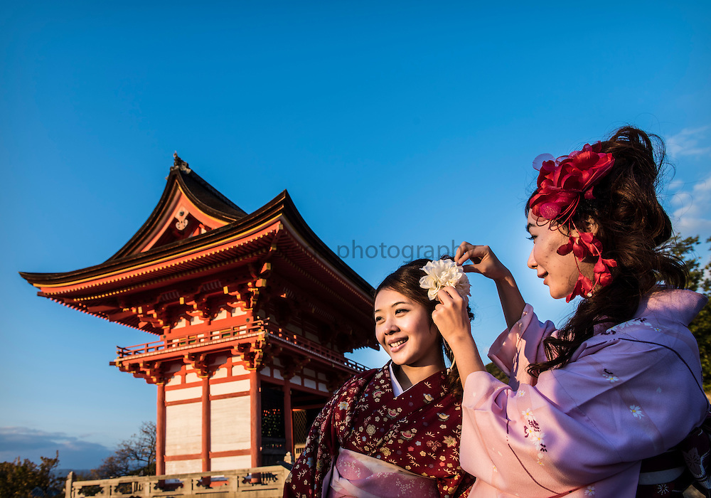 Girls dressed in the traditional way in Yasaka Shrine, Kyoto.