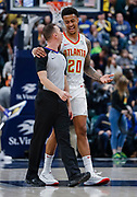 INDIANAPOLIS, IN - DECEMBER 31: NBA referee Justin Van Duyne #64 talks with John Collins #20 of the Atlanta Hawks during the game against the Indiana Pacers at Bankers Life Fieldhouse on December 31, 2018 in Indianapolis, Indiana. NOTE TO USER: User expressly acknowledges and agrees that, by downloading and or using this photograph, User is consenting to the terms and conditions of the Getty Images License Agreement. (Photo by Michael Hickey/Getty Images) *** Local Caption *** Justin Van Duyne; John Collins