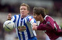 Fotball<br /> Skottland 2004/2005<br /> Foto: SBI/Digitalsport<br /> NORWAY ONLY<br /> <br /> Hearts v Kilmarnock, Scottish Cup fourth round, Tynecastle Park, Edinburgh. 05/02/2005<br /> <br /> Saulius Mikoliunas gets the better of Gary Locke