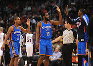 Feb. 4, 2011; Phoenix, AZ, USA; Oklahoma City Thunder guard Eric Maynor (6) and teammate guard James Harden (13) are congratulated by teammate forward Kevin Garnet (35) while playing against the Phoenix Suns at the US Airways Center. The Thunder defeated the Suns 111-107. Mandatory Credit: Jennifer Stewart-US PRESSWIRE