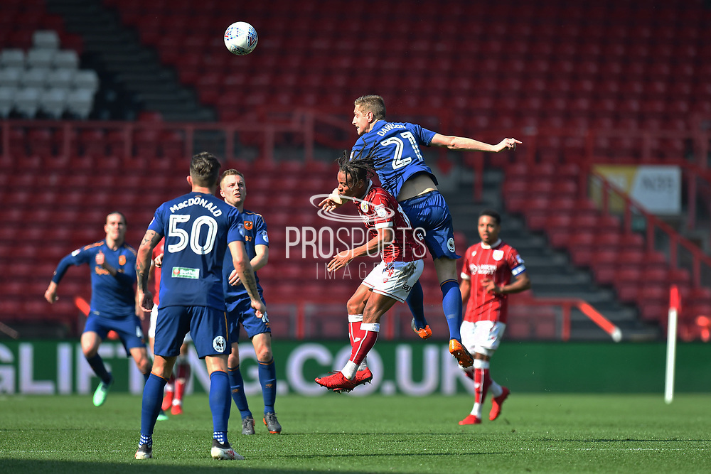 Michael Dawson (21) of Hull City leaps above Bobby Reid (14) of Bristol City to head the ball during the EFL Sky Bet Championship match between Bristol City and Hull City at Ashton Gate, Bristol, England on 21 April 2018. Picture by Graham Hunt.