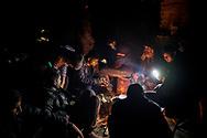 Migrants preparingh 'chai', in one of the abandoned wearhouses next to the Belgrade train station. March 16th 2017, Belgrade, Serbia. Federico Scoppa/CAPTA