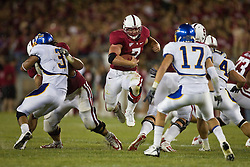 September 19, 2009; Stanford, CA, USA;  Stanford Cardinal running back Toby Gerhart (7) jumps through a hole in the fourth quarter of the San Jose State Spartans game at Stanford Stadium. Stanford defeated San Jose State 42-17.