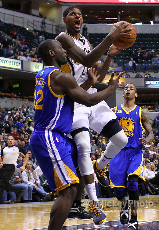 Feb. 28, 2012; Indianapolis, IN, USA; Indiana Pacers shooting guard Paul George (24) shoots the ball against Golden State Warriors guard Charles Jenkins (22) at Bankers Life Fieldhouse. Indiana defeated Golden State 102-78. Mandatory credit: Michael Hickey-US PRESSWIRE