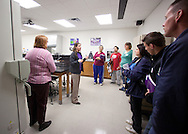 Trinity Renchin (second on left), student ambassador, leads a tour of prospective students and their parents during an open house in a lab at Waldorf College in Forest City, Iowa on Saturday, May 14, 2011.
