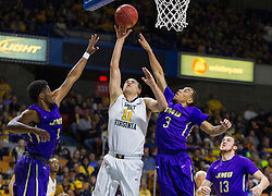 Nov 16, 2015; Charleston, WV, USA; West Virginia Mountaineers forward Nathan Adrian shoots under the basket during the first half against the James Madison Dukes at the Charleston Civic Center. Mandatory Credit: Ben Queen-USA TODAY Sports