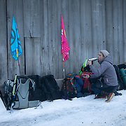 The second day of the Strike WEF march on Davos, 20th of January 2020, Switzerland. Lunch break. The march started in Schiers and walked the 24 kilomers to Klosters.  The aim is to finish in Davos with a public meeting in the town on the day the WEF begins. The march is a three day protest against the World Economic Forum meeting in Davos. The activists want climate justice and think that The WEF is for the world's richest and political elite only.