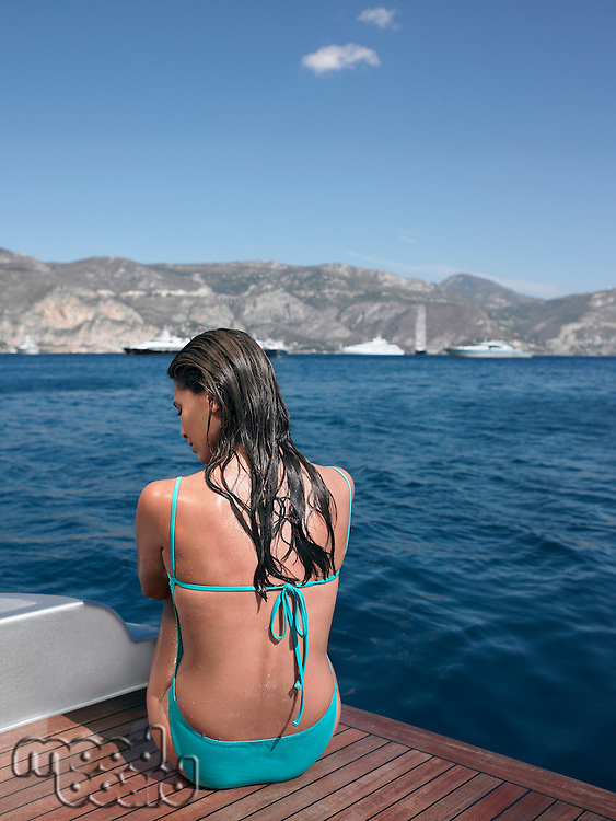 Back View of Woman Sitting on Boat