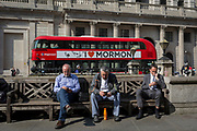 Londoners check their messages opposite the Bank of England on Threadneedle Street in the City of London, the capital's financial district also known as the Square Mile, on 6th April 2017, in London, England.