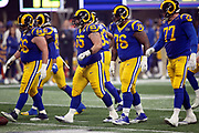 The offensive line including Los Angeles Rams offensive guard Austin Blythe (66), Rams center John Sullivan (65), Rams offensive guard Rodger Saffold (76), and Rams offensive tackle Andrew Whitworth (77) break from the huddle and walk to the line of scrimmage during the NFL Super Bowl 53 football game against the New England Patriots on Sunday, Feb. 3, 2019, in Atlanta. The Patriots defeated the Rams 13-3. (©Paul Anthony Spinelli)