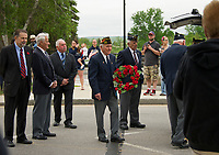 City officials with members of the VFW and American Legion stop at the Main Street bridge along the parade route to honor those who died at sea during the Laconia Memorial Day parade and service held Monday morning.  (Karen Bobotas/for the Laconia Daily Sun)