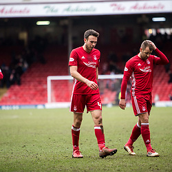 Aberdeen v Celtic, SPrem, 25th February 2018<br /> <br /> Aberdeen v Celtic, SPrem, 25th February 2018 &copy; Scott Cameron Baxter | SportPix.org.uk<br /> <br /> Gary Mackay-Stevens, Andrew Considine and Niall McGinn leave the pitch at full time.