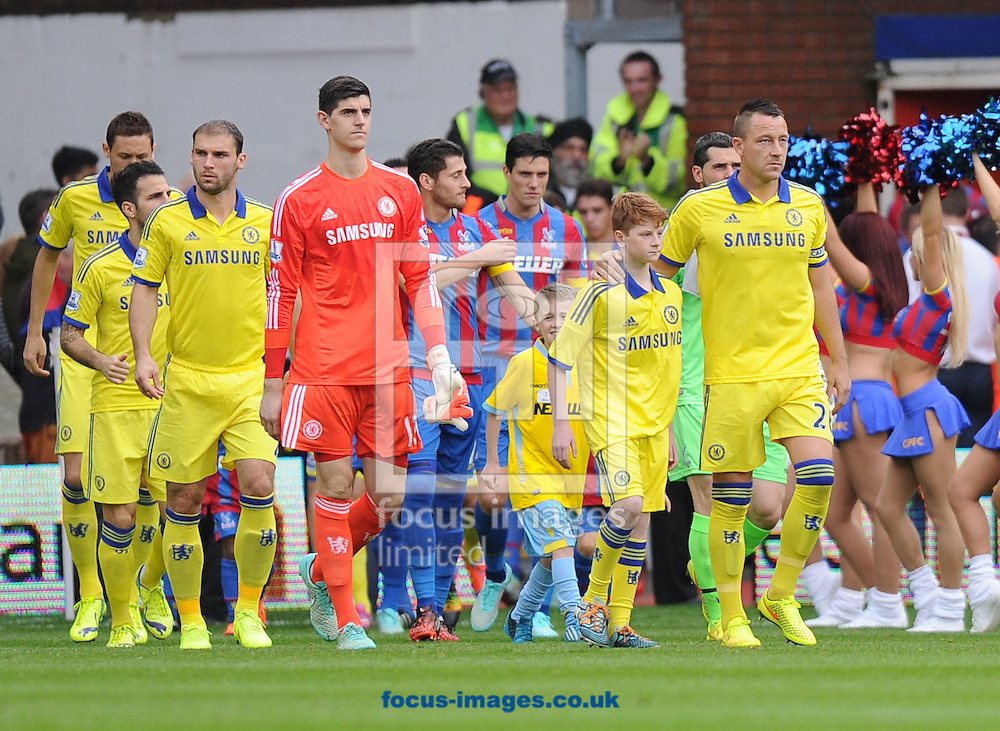 Chelsea captain John Terry making his 500th appearance for the team leads out his players for the Barclays Premier League match at Selhurst Park, London<br /> Picture by Alan Stanford/Focus Images Ltd +44 7915 056117<br /> 18/10/2014