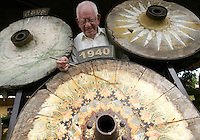 Carlos Chaverri, 78, shows old wheels from traditional cars at his Traditional Car Factory in Sarchi, about 50 km  north of San Jose, Costa Rica on Friday November 25, 2005. The Caverri's family own this factory and shop since 1903. This kind of painted car is a symbol of the folk culture in Costa Rica. UNESCO recognize this cars as Humankind Nonmaterial Patrimony. (Photo/Cristobal Herrera).
