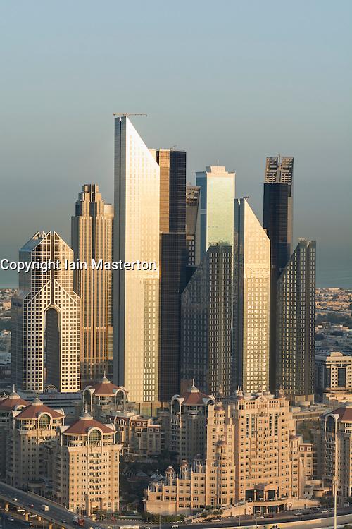 Skyline of skyscrapers on Sheikh Zayed Road at sunrise  in Dubai United Arab Emirates