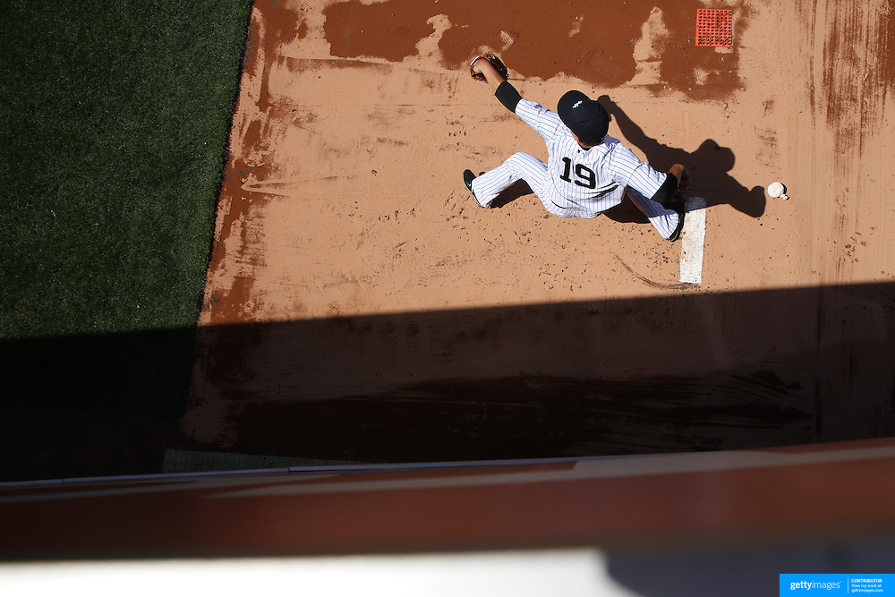 Pitcher Masahiro Tanaka, New York Yankees, warming up in the bull pen before the New York Yankees Vs Toronto Blue Jays season opening day at Yankee Stadium, The Bronx, New York. 6th April 2015. Photo Tim Clayton