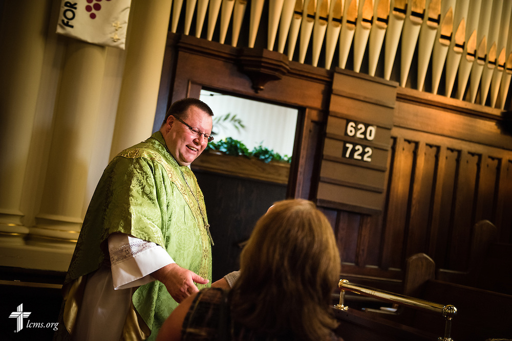 The Rev. Kent Tibben talks to parishioners following Divine Service at Trinity Lutheran Church on Wednesday, July 15, 2015, in Danville, Ill. LCMS Communications/Erik M. Lunsford