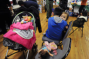One year old Savannah Santana is cradled by her older brother Vincent Santana, age nine, at the Worship & Praise Community Church in the South Beach neighborhood of Staten Island, N.Y. Their mother, Jennifer Santana, said they barely escaped Hurricane Sandy when it hit earlier in the week, and are now taking refuge at the church.