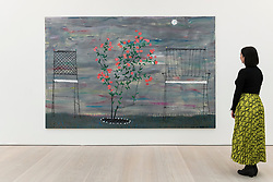 """© Licensed to London News Pictures. 14/03/2019. LONDON, UK. A staff member views """"Rosebush"""", 2017, by Tom Howse. Preview of Kaleidoscope, a new exhibition at the Saatchi Gallery featuring the work of 9 contemporary artists.  The show runs 15 March to 5 May 2019.  Photo credit: Stephen Chung/LNP"""
