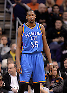 Jan. 14, 2013; Phoenix, AZ, USA; Oklahoma City Thunder forward Kevin Durant (35) stands on the court during the game against the Phoenix Suns at the US Airways Center. The Thunder defeated the Suns 102-90. Mandatory Credit: Jennifer Stewart-USA TODAY Sports