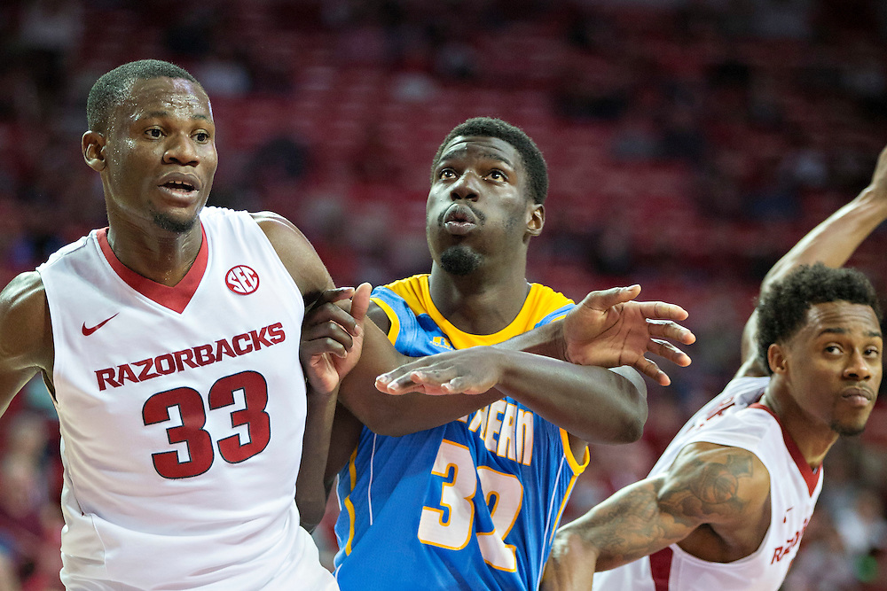 FAYETTEVILLE, AR - NOVEMBER 13:  Moses Kingsley #33 and Athlon Bell #5 of the Arkansas Razorbacks block out D'Arian Allen #32 of the Southern University Jaguars at Bud Walton Arena on November 13, 2015 in Fayetteville, Arkansas.  The Razorbacks defeated the Jaguars 86-68.  (Photo by Wesley Hitt/Getty Images) *** Local Caption *** Moses Kingsley; Athlon Bell; D'Arian Allen