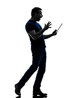 one  man holding digital tablet surprised in silhouette on white background