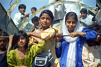 Pakistan, Sehwan Sharif, 2004. Wearing their best clothes, girls from the countryside wait for their parents to return from the shrine of Hazrat Lal Qalander. Pilgrims arrive every morning from all over the area.