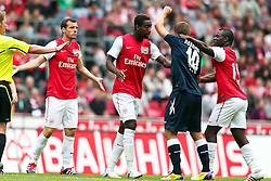 23.07.2011,  Rhein Energie Stadion, Koeln, GER, FSP, 1. FC Koeln vs Arsenal London, im Bild:  Denilson (Arsenal #15) (R) und Lukas Podolski (Koeln #10) (M) sowie Sebastien Squillaci (Arsenal #18) (L) und Johan Djourou (Arsenal #20) . ...// during the friendly match, 1. FC Koeln vs Arsenal London on 2011/07/23, Rhein-Energie Stadion, Köln, Germany. EXPA Pictures © 2011, PhotoCredit: EXPA/ nph/  Mueller *** Local Caption ***       ****** out of GER / CRO  / BEL ******