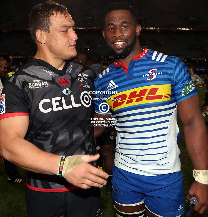 DURBAN, SOUTH AFRICA - MAY 27: Coenie Oosthuizen of the Cell C Sharks with Siya Kolisi (captain) of the DHL Stormers during the Super Rugby match between Cell C Sharks and DHL Stormers at Growthpoint Kings Park on May 27, 2017 in Durban, South Africa. (Photo by Steve Haag/Gallo Images)