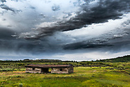 Dynamic stormy sky decorating the horizon in Jackson Hole Wyoming at the historic Cunningham Cabin of Grand Teton National Park