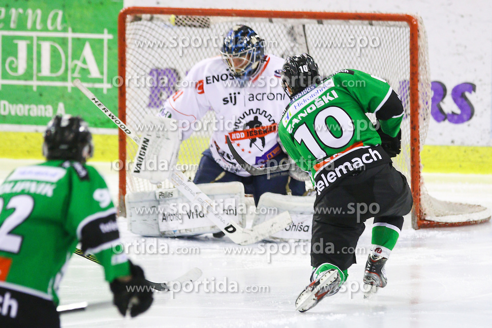 Tom Zanoski of Olimpija vs Aleksis Ahlqvist of Jesenice during ice hockey game between HDD Telemach Olimpija and SIJ Acroni Jesenice in 3rd leg of Finals of Slovenian National Championship 2015, on April 13, 2015 in Hala Tivoli, Ljubljana, Slovenia. Photo by Matic Klansek Velej / Sportida