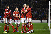 Nottingham Forest defender Joe Warrall (42) kisses Nottingham Forest forward Ben Brereton (17) after scoring from the penalty spot to make it 3-1 during the The FA Cup 3rd round match between Nottingham Forest and Arsenal at the City Ground, Nottingham, England on 7 January 2018. Photo by Jon Hobley.