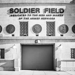 Soldier Field stadium sign vertical black and white photo. Soldier Field is home to the Chicago Bears NFL football team. Copyright ⓒ 2015 Paul Velgos with All Rights Reserved.