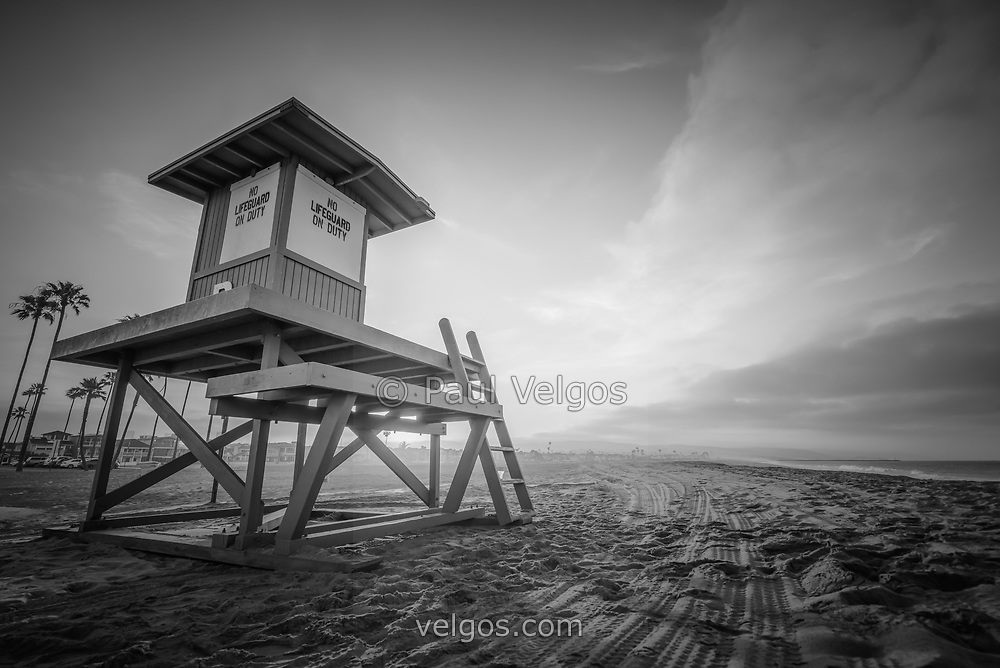 Lifeguard Tower B sunrise black and white photo in Newport Beach California on Balboa Peninsula. Newport Beach is a popular coastal city along the Pacific Ocean in Southern California. Photo is high resolution. Copyright ⓒ 2017 Paul Velgos with All Rights Reserved.