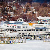 As seen from atop of the Highlands bridge, Highlands New Jersey the Shrewbury River has completely frozen over with ice due to a extended period of freezing temperatures.     This is Bahr's Sea Food Restaurant and boating docks completely iced in.