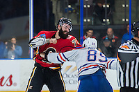 PENTICTON, CANADA - SEPTEMBER 17: Matt Benning #83 of Edmonton Oilers drops the gloves with Hunter Smith #71 of Calgary Flames on September 17, 2016 at the South Okanagan Event Centre in Penticton, British Columbia, Canada.  (Photo by Marissa Baecker/Shoot the Breeze)  *** Local Caption *** Matt Benning; Hunter Smith;