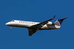 United Express Bombardier CRJ-200ER CL-600-2B19 (registration N938SW) approaches San Francisco International Airport (SFO) over San Mateo, California, United States of America