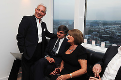 Left to right, SIMON REUBEN, ROBIN BIRLEY and LADY ANNABEL GOLDSMITH at The Reuben Foundation and Virgin Unite Haiti Fundraising dinner held at Altitude 360 in Millbank Tower, London on 26th May 2010.