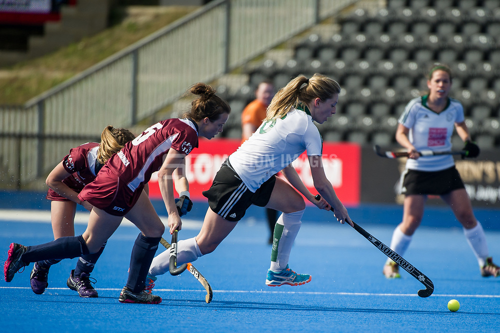 Buckingham's Phoebe Richards goes past Rachel Evans of Wimbledon. Wimbledon v Buckingham - Investec Women's Hockey League Finals, Lee Valley Hockey & Tennis Centre, London, UK on 23 April 2017. Photo: Simon Parker