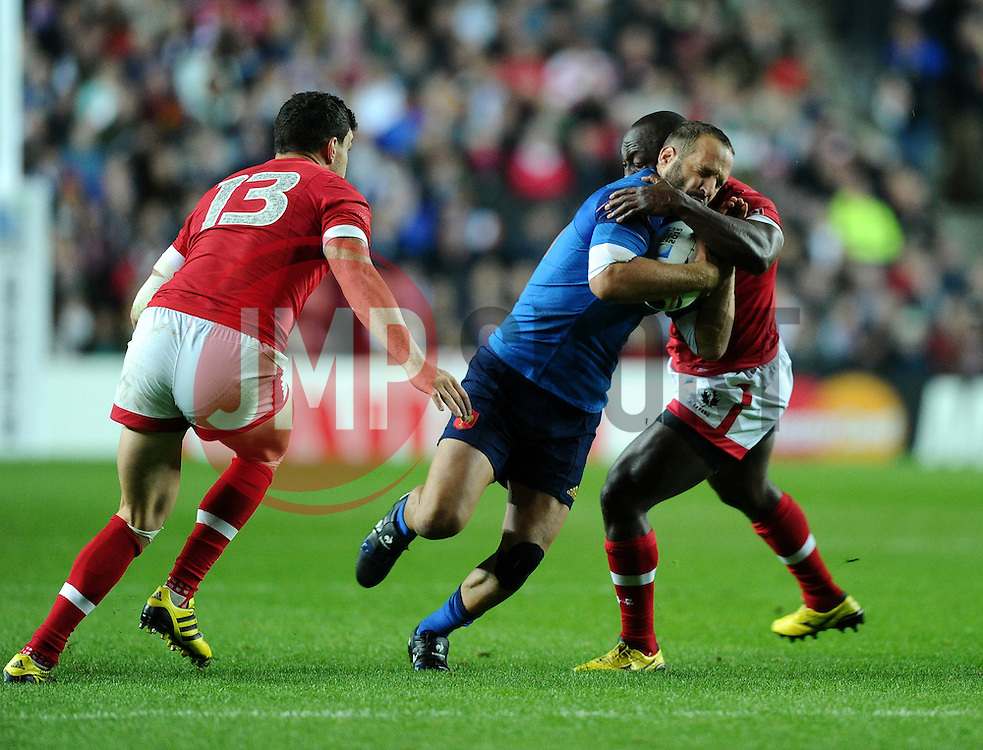 Nanyak Dala of Canada tackles Frederic Michalak of France  - Mandatory byline: Joe Meredith/JMP - 07966386802 - 01/10/2015 - Rugby Union, World Cup - Stadium:MK -Milton Keynes,England - France v Canada - Rugby World Cup 2015