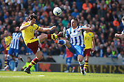 Burnley midfielder Joey Barton & Brighton central midfielder Beram Kayal compete for a high ball during the Sky Bet Championship match between Brighton and Hove Albion and Burnley at the American Express Community Stadium, Brighton and Hove, England on 2 April 2016. Photo by Bennett Dean.