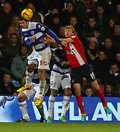 Picture by David Horn/Focus Images Ltd +44 7545 970036<br /> 07/12/2013<br /> Charlie Austin of Queens Park Rangers beats Chris Taylor of Blackburn Rovers in a aerial challend during the Sky Bet Championship match at the Loftus Road Stadium, London.