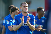 AFC Wimbledon midfielder Dylan Connolly (16) clapping during the EFL Sky Bet League 1 match between AFC Wimbledon and Bristol Rovers at the Cherry Red Records Stadium, Kingston, England on 19 April 2019.