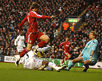 Photo: Paul Greenwood/Sportsbeat Images.<br />Liverpool v Bolton Wanderers. The FA Barclays Premiership. 02/12/2007.<br />Liverpool's Fernando Torres is tackled by Abdoulaye Meitye in the area.